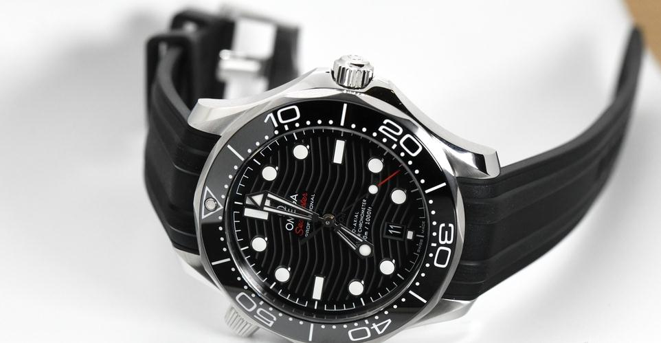 The stainless steel copy Omega Seamaster 300M 210.32.42.20.01.001 watches have black rubber straps.