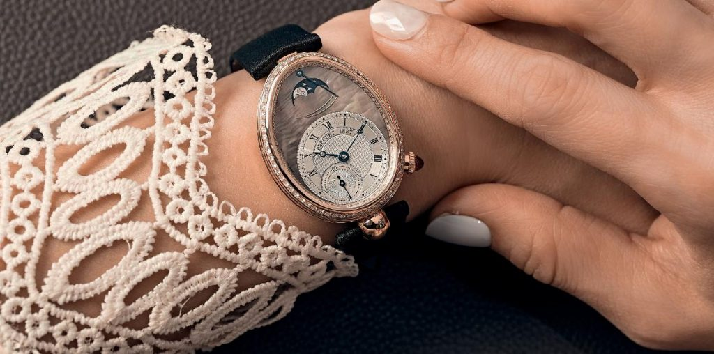 The oval fake Breguet Reine De Naples watches with off-centre dials are suitable for females.