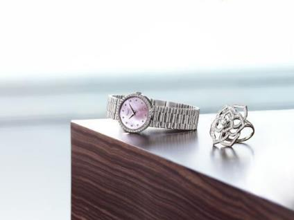 The round replica watches have pink dials.