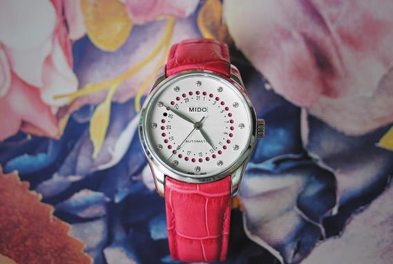 The stainless steel copy watches have pink leather straps.