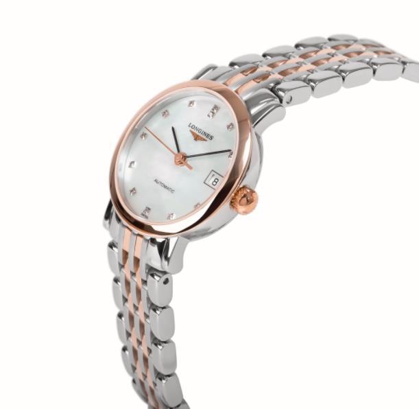 The white dial fake watch has diamond hour marks.