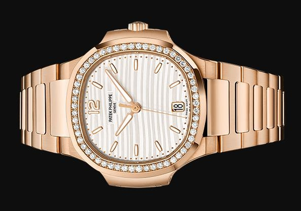 The off-white dial fake watch is decorated with diamonds.